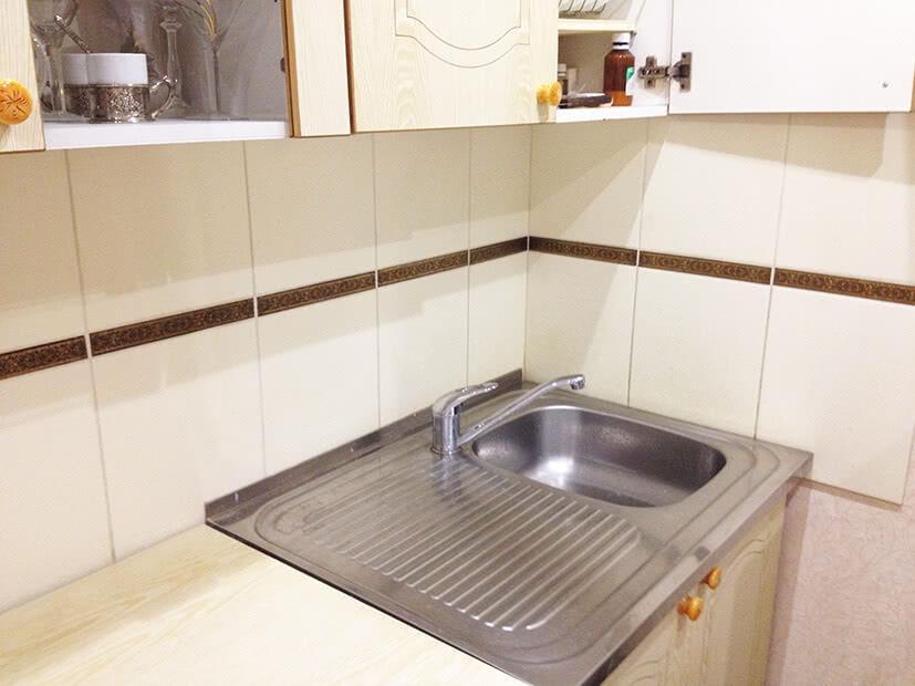 Облицовка стен керамической плиткой на кухне